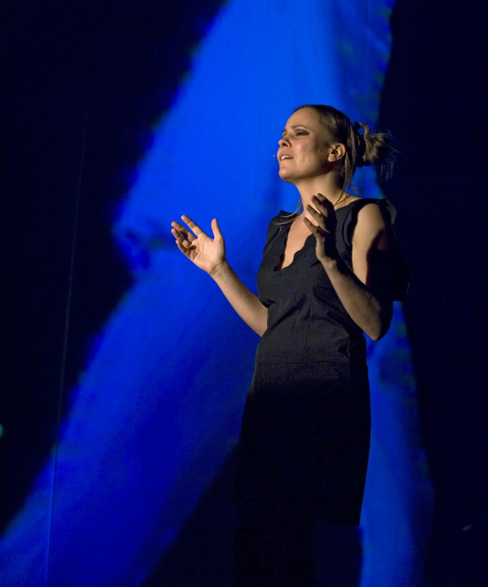 "Sara Kraft wearing a black dress, which was a costume in the production, ""HyperReal."""